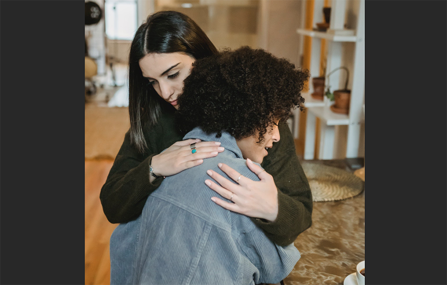 grieving woman hugging person